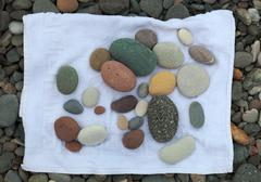 pebbles on a towel. batumi. georgia. - stock photo