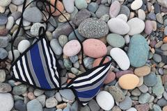 Stock Photo of swimsuit top on pebbles. batumi. georgia.