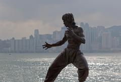 Bruce lee statue on the avenue of stars. tsim sha tsui. hong kong. Stock Photos