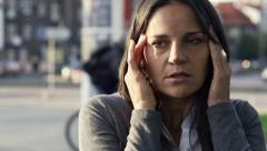 Tired businesswoman having headache in the city HD - stock footage