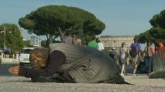 A Begger with the Colosseum in background Stock Footage