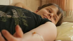 A boy getting an intravenous infusion - stock footage