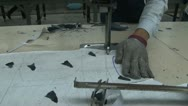 Stock Video Footage of Asian Garment Industry Workers: CU metallic glove while worker cuts fabric
