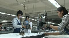 Asian Garment Industry Factory: WS workers at the cutting table Stock Footage