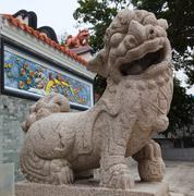 Lion in front of the entrance to pak tai temple.  cheung chau. hong kong. Stock Photos