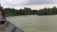 Travelling up a Vietnamese river in a boat Stock Footage