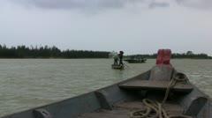 Vietnamese fishermen casting a net - stock footage