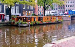 houseboat in amsterdam canal - stock photo