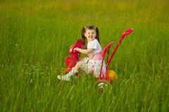 comical child on a bicycle - grimace - stock photo