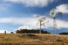A rural landscape with windmill. near oberon. new south wales. australia. Stock Photos