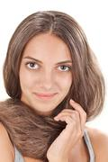 face studio portrait of young lady with long hairs twisted round like a scarf - stock photo