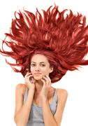 Young beautiful redhead woman with scattered long hairs Stock Photos