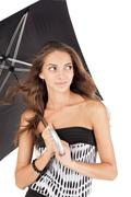 Stock Photo of young beautiful woman with black umbrella portrait