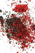 red and black color crumbled eye shadows isolated on white - stock photo