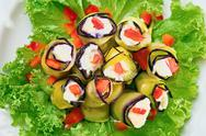 Stuffed egg plant (aubergine) rolls with paprika and mayonnaise Stock Photos