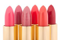 multicolored color lipsticks arranged in two lines isolated on white, shallow - stock photo