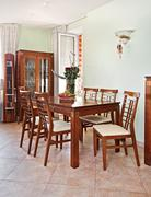 dining room interior with classic wooden furniture - stock photo