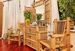 wooden ethnic bamboo boudoir furniture - stock photo
