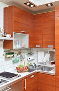 part of kitchen interior with wooden furniture and sink - stock photo