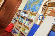 Stock Photo of part of nursery room interior with wooden shelving