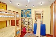 Stock Photo of nursery room interior with two-high wooden bed