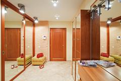Stock Photo of elegance anteroom interior in warm tones with hallstand and mirror