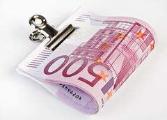 Bundle of 500 euro bank notes fasten with paper clip Stock Photos