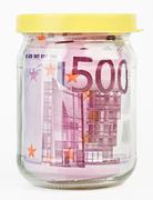 500 euro bank notes in a glass jar - stock photo