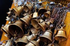 Many metal sacrificial bells hanging on chain, kathmandu, nepal Stock Photos