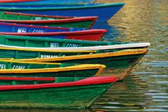 Color boats on phewa lake, pokhara, nepal Stock Photos