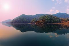 beautiful green hills landscape from boat view on phewa lake, pokhara, nepal - stock photo