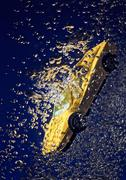 Yellow sportcar accident, going down underwater with air bubbles Stock Photos