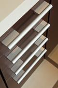 brown hardwood drawers with metal handle - stock photo