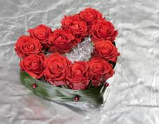 valentine's day rose decoration bouquet on silver - stock photo
