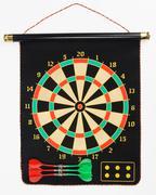 Darts set on a black sheet board Stock Photos