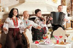 Ukrainian ethnic music band concert in traditional restaurant interior Stock Photos