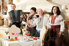 ukrainian ethnic music band concert in traditional restaurant interior - stock photo