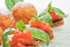 Salmon canape with basil Stock Photos