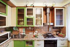 green kitchen interior with many utensils - stock photo