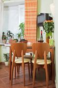 kitchen table and chairs with fruit basket - stock photo