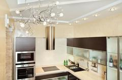 modern kitchen interior in warm tones top view - stock photo