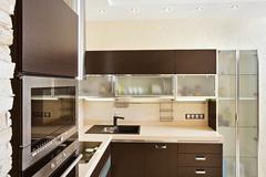 modern kitchen interior with hardwood furniture - stock photo