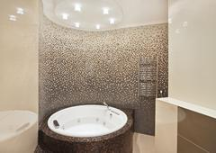 bathroom with jacuzzi and mosaic - stock photo
