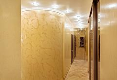 passage with a mirror wardrobe and column in warm tones - stock photo