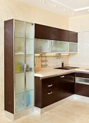 part of modern kitchen interior with cupboard in warm tones - stock photo