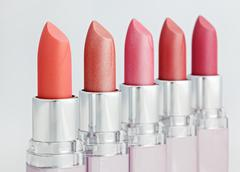 Stock Photo of color lipsticks arranged in line isolated on white, shallow depth of field