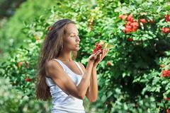 Stock Photo of beautiful woman with guelder rose