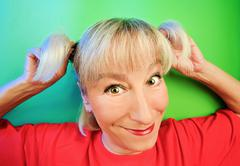 Funny cunning woman portrait on vivid color background Stock Photos