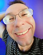 funny happy man in glasses portrait on vivid color background - stock photo