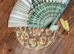 Bali fan on the table in orient style Stock Photos